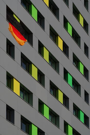 German German Flag Patriotic Patriotism SUPPORT Supporting My Team Apartment Architecture Backgrounds Building Building Exterior Built Structure City Day Flag Germany Modern No People Outdoors Pattern Repetition Residential District Supporter Window Yellow #FREIHEITBERLIN The Architect - 2018 EyeEm Awards #urbanana: The Urban Playground
