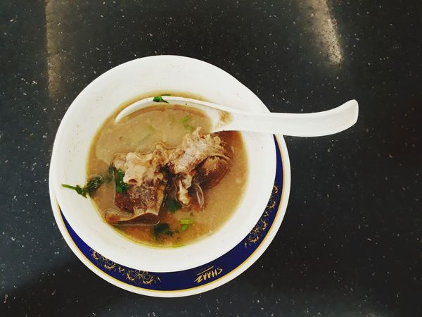 Sup kambing org mutton soup Indian muslim style eaten with naan or may be rice spicy yet delicious Directly Above Plate Table Close-up Food And Drink Soup Served Soup Bowl Stew Gravy Prepared Food Serving Dish Spring Onion Serving Size