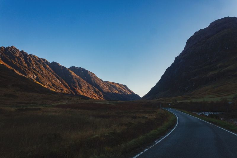 The Lost Valley Road Mountain The Way Forward Tranquil Scene Scenics Transportation Nature Landscape Clear Sky Tranquility Asphalt Mountain Range Day Outdoors Winding Road Beauty In Nature No People Mountain Road Sky Glencoe Scotland Scotland 💕 Sunrise Landscape_Collection Landscape_photography
