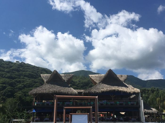 Thatched Roof Sky Mountain Cloud - Sky Day Outdoors Beauty In Nature No People Nature Shelter Scenics Tranquility Landscape Blue Mountain Range Architecture Tree