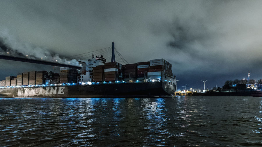 containership in motion Artificial Light Container Containership Hamburg Harbour January Motion Blur Nikon Smoke Water Reflections Windmill Architecture Bridge Building Exterior Built Structure Cloud - Sky darkness and light Elbe Harbor Köhlbrandbridge Moored Nature Nautical Vessel Night No People Outdoors River Sea Sky Transportation Water Waterfront