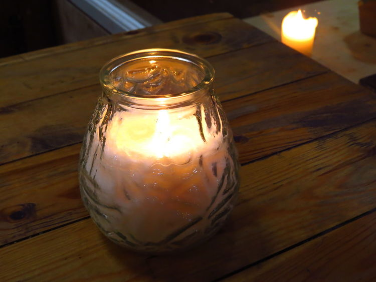 Paper Island in Copenhagen Candle Candle Flame Candle Light Candlelight Candles Comfort Copenhagen Cosy Flame Glass Glass Lantern Hand Lantern Hygge Illuminated Indoors  Lantern Light Lighting Equipment Paper Island Papirøen Storm Lamp Wood Wood - Material Wooden Wooden Table