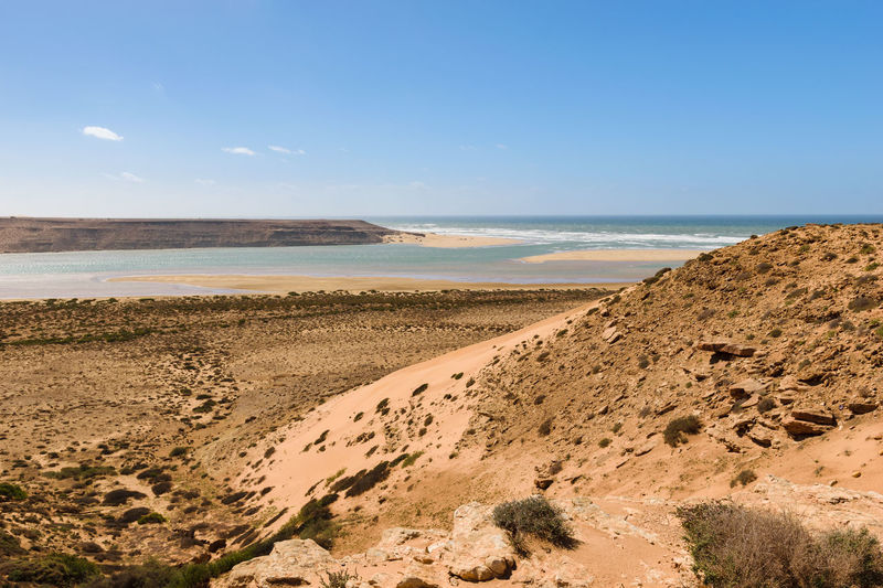 Image of the river mouth of Wadi Draa flowing in the Atlantic Ocean in Morocco. Atlantic Ocean Moroccan Morocco Nature Africa Beach Beauty In Nature Day Ecology Flora Horizon Over Water Nature No People Outdoors River River Outfall Sand Scenics Sea Sky Tranquil Scene Tranquility Wadi Wadi Draa Water