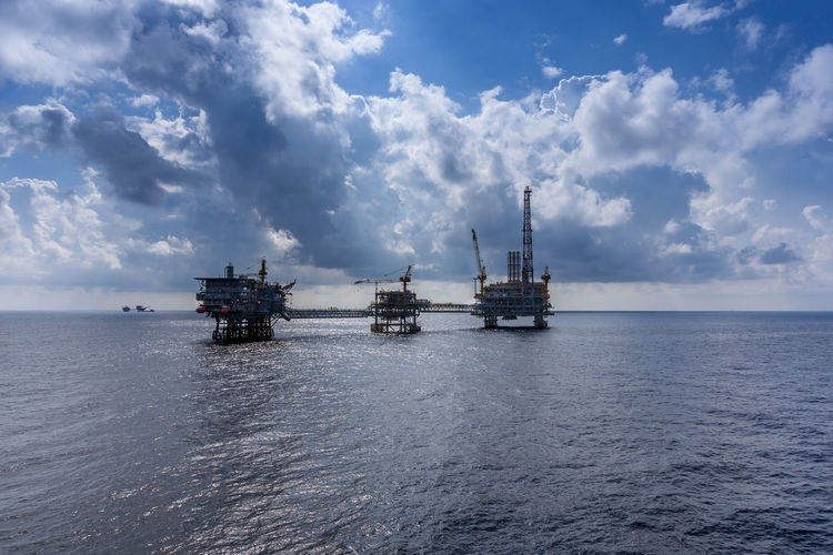 oil field Ocean Wave Horizon Over Water Oil Rig Offshore Offshore Life Gas Oil And Gas Industry Petroleum Upstream Installation Drilling Exploration Drilling Rig Offshore Platform Oil Pump Sea Oil Industry Water UnderSea Nautical Vessel Silhouette Sky Crude Oil Seascape Gasoline Oil Field Cloud - Sky Oil Well
