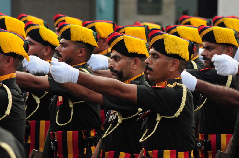 An Indian army battalion during a parade. Moustache Achievement Adult Army Army Life Army Soldier Celebration Ceremony Day Discipline Fan - Enthusiast Large Group Of People March Men Military Outdoors People Pride Real People Soccer Standing Strength Togetherness Young Adult Young Men