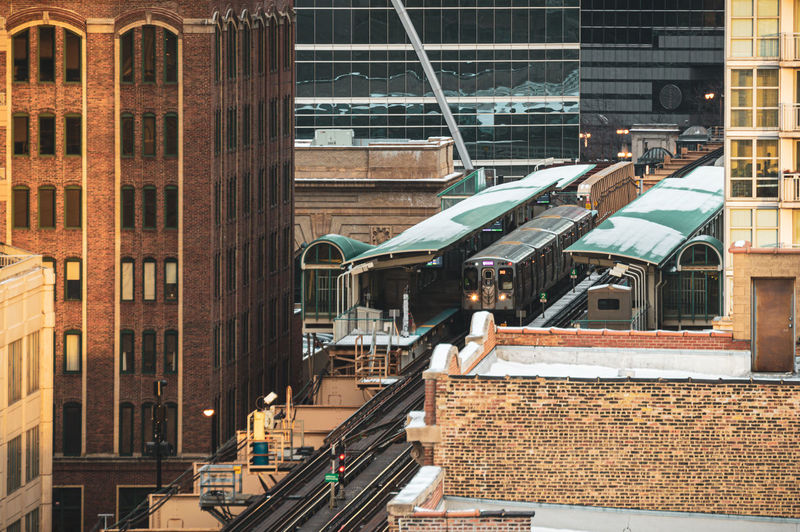 Railroad tracks amidst buildings in city