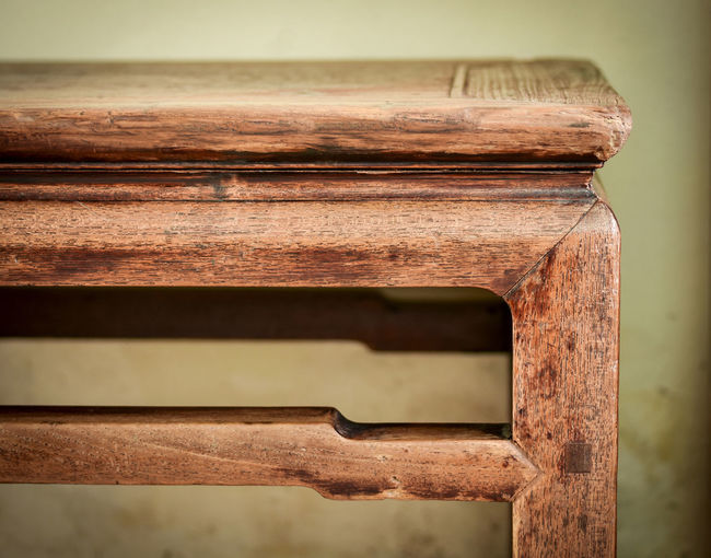 Detail of antique oriental wooden bench. Carpentry work,details finishing and patina of vintage furniture. Antique Bench Carpentry Work Classic Joinery Old-fashioned Preserved Teak Wood Art Charming Close-up Collection Detail Furniture Groove Interior Old-fashioned Oriental Style Patina Pin Style Texture Vintage Wood - Material Wooden
