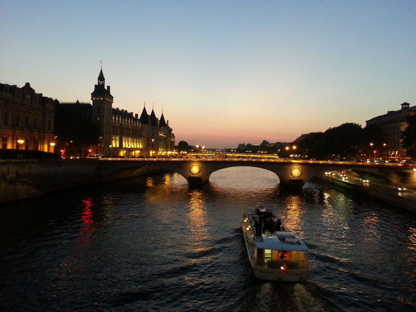 Pont au Change, Paris EyeEmNewHere Paris ParisByNight Seine Architecture Bridge - Man Made Structure Building Exterior Built Structure Chain Bridge City Clear Sky Connection Illuminated Nature Nautical Vessel Night No People Outdoors River Sky Sunset Transportation Travel Destinations Water Waterfront