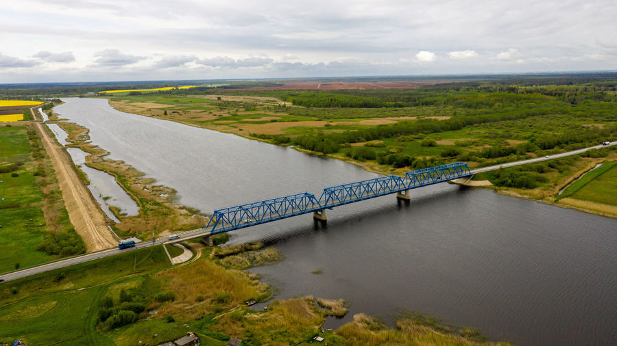 Aerial panoramic view from above to the bridge over the river lielupe near kalnciems, latvia