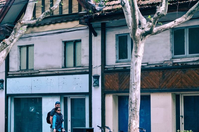 Shanghai EyeEm Selects Built Structure Architecture Building Exterior Building Real People Lifestyles Day Window One Person Men Outdoors Leisure Activity Walking Residential District Standing Nature House City Sunlight