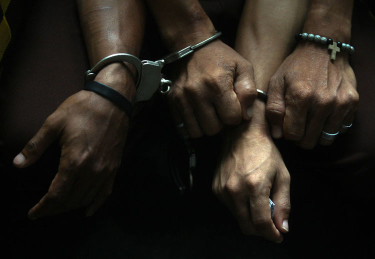 Cropped hands with handcuffs