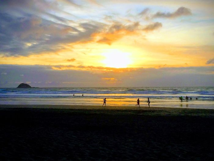 Playing in the Sun Nature On Your Doorstep Nature Nature_collection Sunset_collection Silhouette Muriwai Beach Lifeisbeautiful Nature Photography Full Length Seascape Horizon Over Water Wave Romantic Sky Shore Dramatic Sky Ocean Sandy Beach Surf Tide