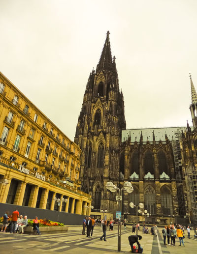 Cologne Dom Cathedral Adult Architecture Building Exterior Built Structure City Day Dom Cathedral History Large Group Of People Men Outdoors People Place Of Worship Real People Religion Sky Spirituality Tourism Travel Travel Destinations Women