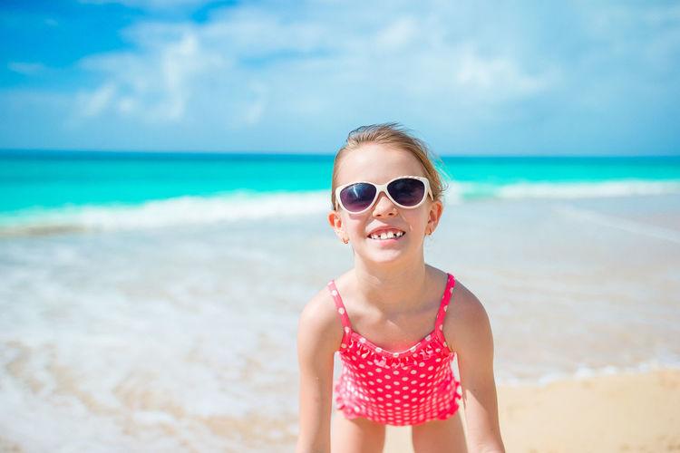 Portrait of boy wearing sunglasses on beach