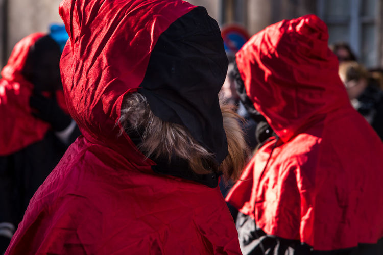 People Wearing Red Costume In City