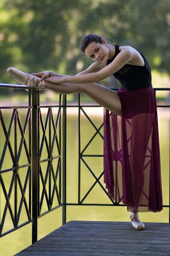 Portrait of young ballerina practicing in balcony
