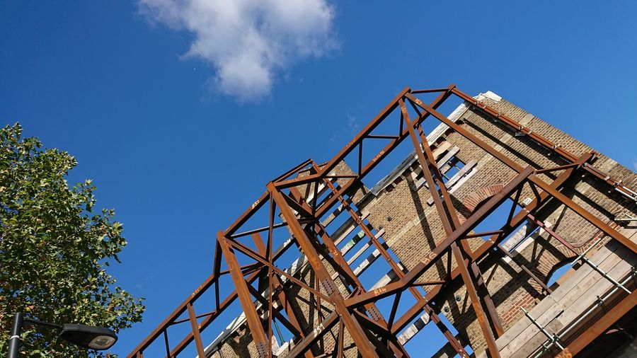 EyeEm Selects Sky No People Low Angle View Construction Frame Outdoors Day Tree Architecture Building Exterior Building Restoration Renovation Protection Steel Girders Postcode Postcards