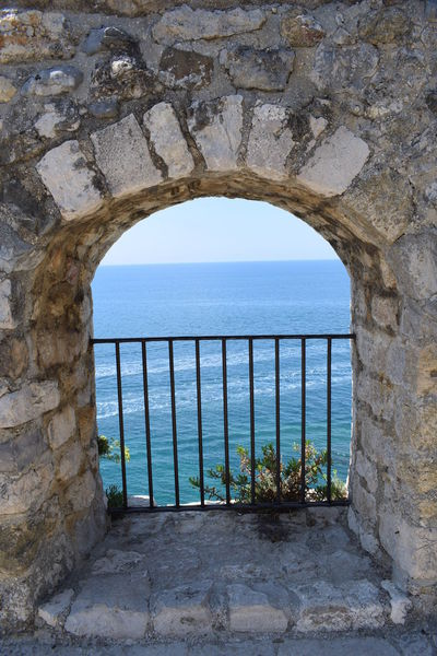 Arch Arched Architecture Built Structure Day History Horizon Horizon Over Water Nature No People Outdoors Scenics - Nature Sea Sky Stone Wall The Past Wall Wall - Building Feature Water Window