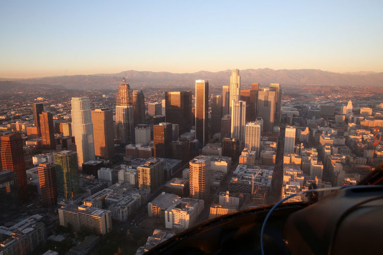 Cityscape against clear sky seen through helicopter