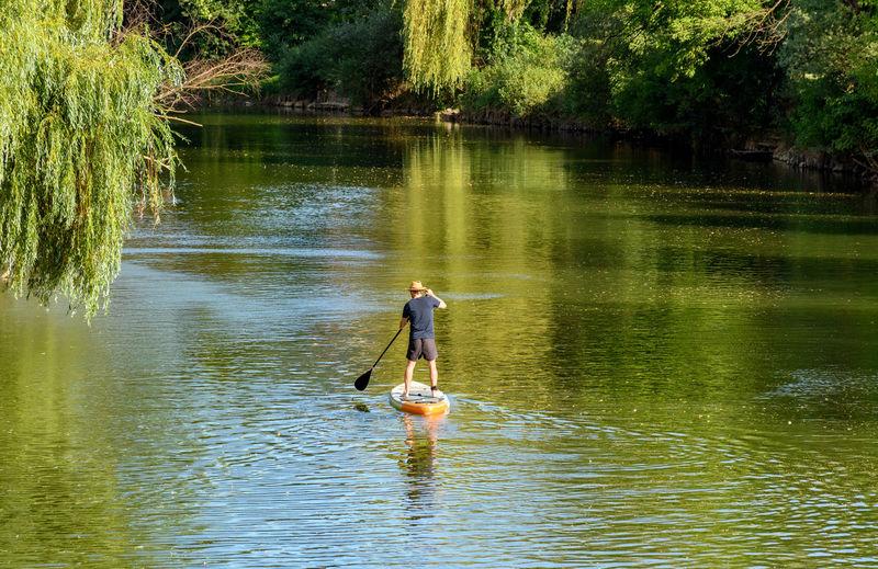 Full length of man surfing in lake