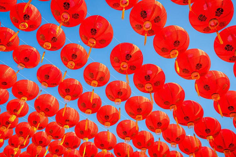 Low angle view of lanterns hanging on red lantern