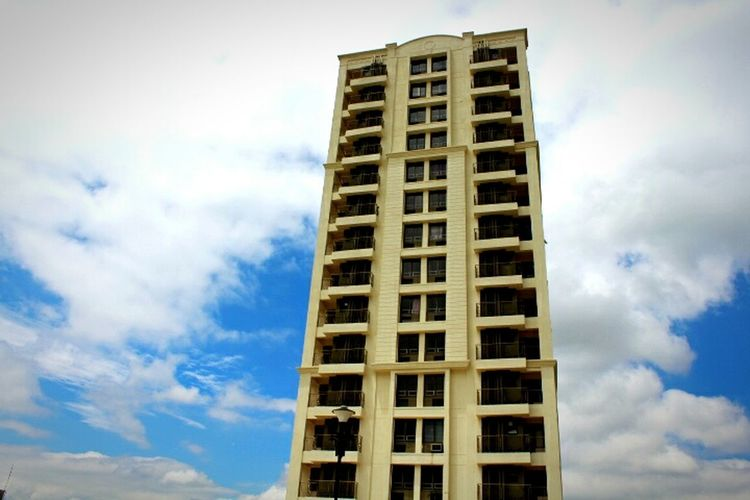 Standing Alone Clouds And Sky Blue Sky Apartment Building Tall Structure Residential Building Cream Colour New Building  Eyeemphoto