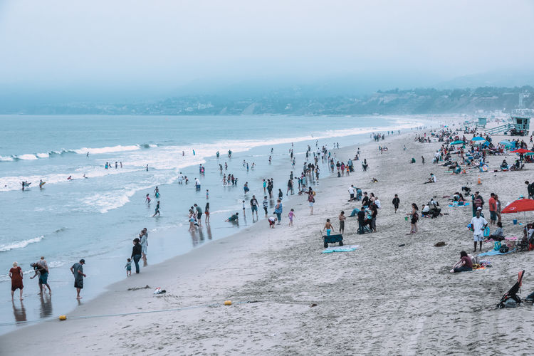 Santa Monica Beach Crowd Group Of People Large Group Of People Leisure Activity Outdoors Pacific Ocean Real People Sea Tourism Tourist Travel Travel Destinations Urban Landscape Vacations Water