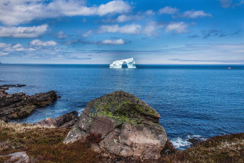 Newfoundland - Iceberg Rocks Iceberg Newfoundland Sea Water Sky Beauty In Nature Cloud - Sky Scenics - Nature Nature No People Day Tranquility Horizon Over Water Beach Blue Outdoors Stay Out My Best Photo