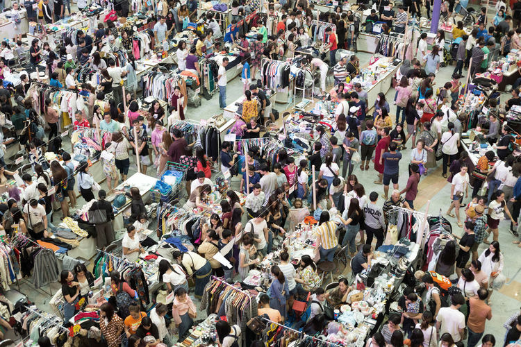 High angle view of people on street market in city