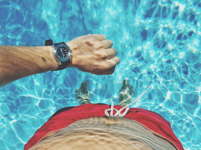 Water Swimming Pool Real People One Person Human Hand Day High Angle View Outdoors Human Body Part Low Section Blue Close-up Nature People Watch EyeEm Selects Summer Sommergefühle EyeEmNewHere EyeEmNewHere