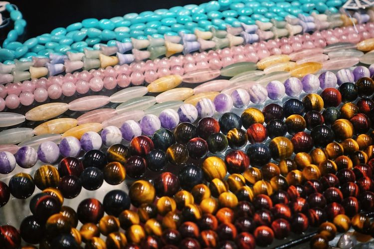 Multi Colored Choice Retail  Large Group Of Objects Variation Abundance Close-up Bead In A Row Arrangement For Sale Full Frame Business Jewelry Sale Order Blackandwhite Pink Color Blue Semiprecious Stones Semipreciousstones Backgrounds Pattern Texture Surface Various Retail Display Shop Window Display Repetition