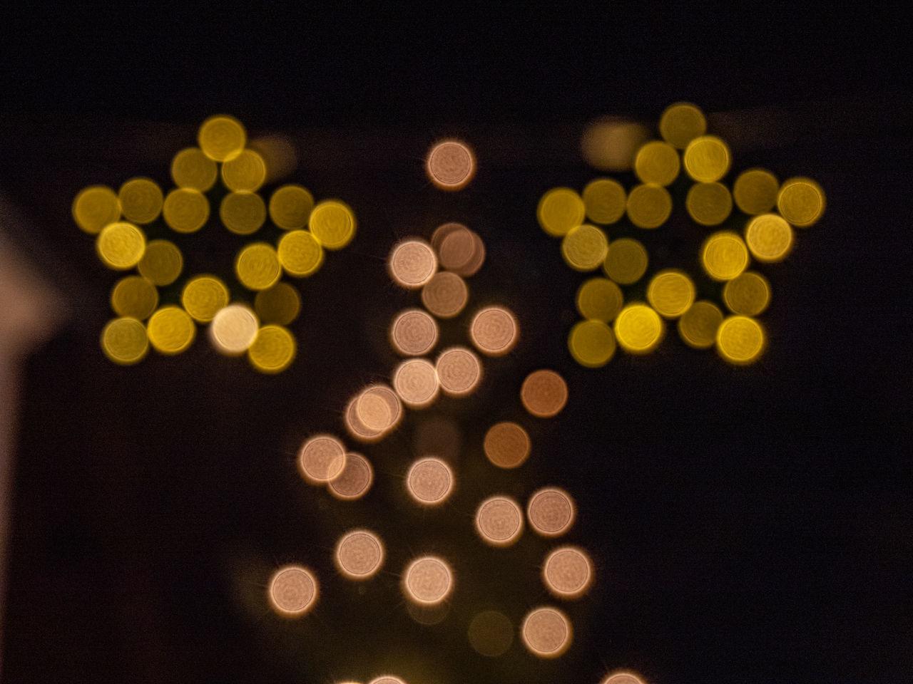 illuminated, defocused, indoors, lighting equipment, night, no people, shape, christmas, black background, glowing, celebration, decoration, christmas decoration, light, holiday, geometric shape, studio shot, circle, christmas lights, pattern, lens flare