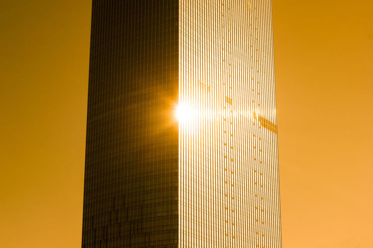 Architecture Bright Building Exterior Built Structure City Day Gold Colored Illuminated Lens Flare Low Angle View Modern No People Outdoors Shiny Sky Skyscraper Sun Sunbeam Sunlight Sunset Yellow