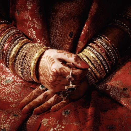 Midsection Of Bride Wearing Bangles