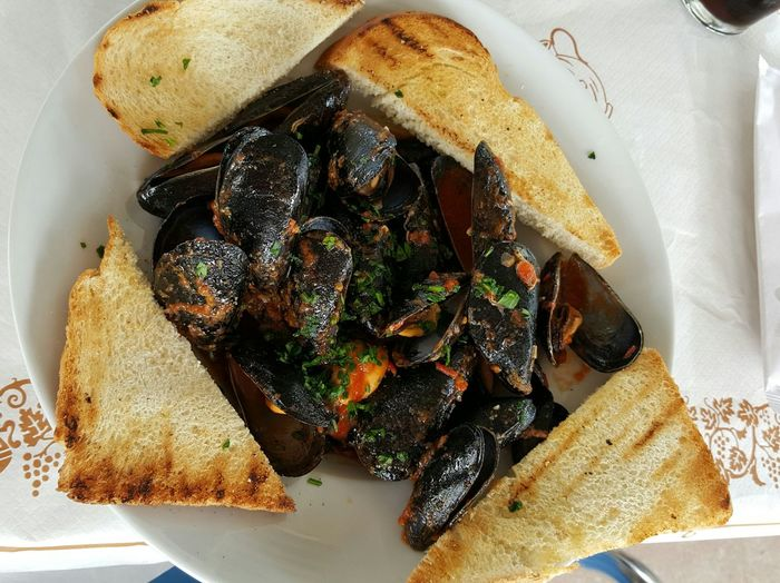 High angle view of mussel soup on table