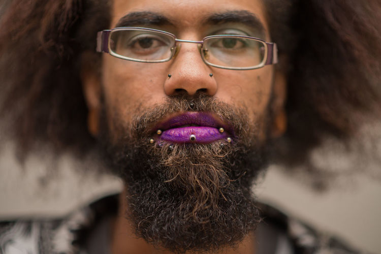 Goth Adult Beard Bearded Body Part Close-up Eyeglasses  Facial Hair Front View Glasses Hair Hairstyle Headshot Human Body Part Human Face Indoors  One Person Portrait Purple Young Adult
