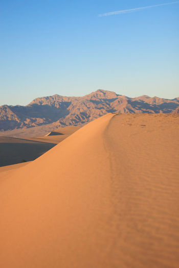 Death Valley Sand Dunes Arid Climate Beauty In Nature Blue California Clear Sky Day Death Valley Desert Landscape National Park Nature No People Outdoors Sand Sand Dune Scenics Sky Sunlight Tranquility Travel USA Vertical