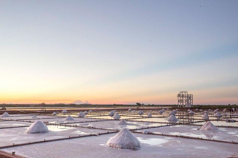 Salt evaporation pond against sky