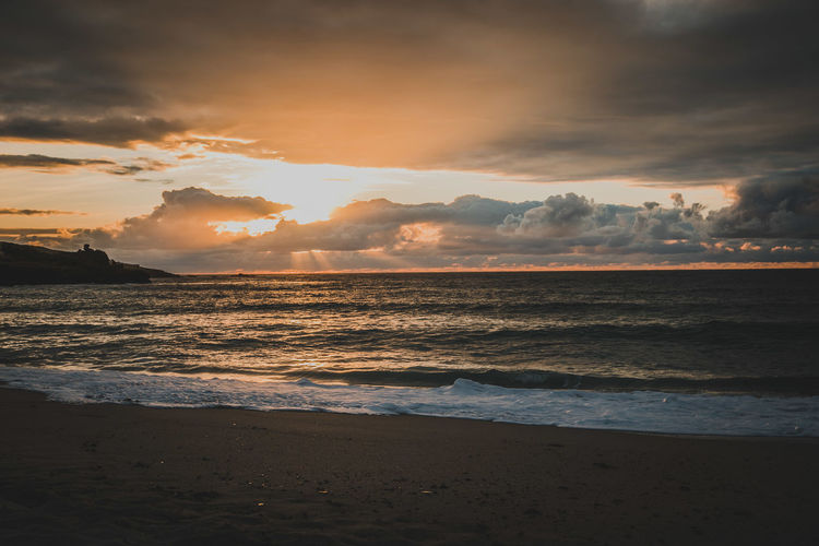 Beach Beauty In Nature Cloud - Sky Horizon Horizon Over Water Idyllic Land Motion Nature No People Outdoors Power In Nature Scenics - Nature Sea Sky Sunset Tranquil Scene Tranquility Water Wave