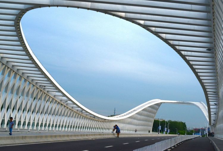 Low angle view of modern bridge against sky