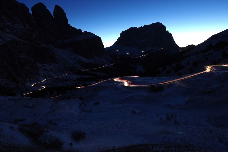 Groedner Joch at the Blue Hour Langkofel Dolomites Passo Gardena Blue Hour Mountain Sasslong Sellaronda Landscape Lighttrails Passroad Winter Olympus OM-D E-M1 Mark II Night Photography Longexposure Val Gardena Groedner Joch Wolkenstein Mountain Range Sella Group Evening Sky Alta Badia Scenics Mountains And Sky Landscape Photograpy Travel Destinations