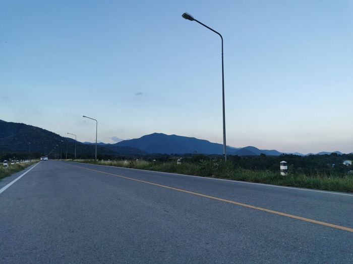 Road by street against sky