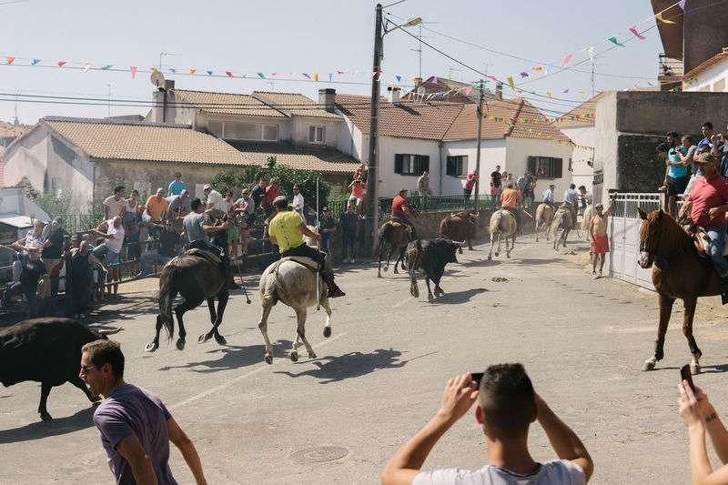 Foios, 22 de Agosto de 2017 Bull Portugal Tradition Architecture Building Exterior Built Structure City Day Domestic Animals Guarda Horse Landscape Large Group Of People Livestock Mammal Men Outdoors People Real People Sky Women