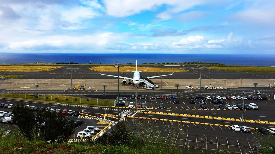 Airport view in Ponta Delgada - Azores/Portugal. The North Atlantic Ocean is in the background. 🌊 Airport Runway Airports Airport Photography Airport Waiting Airportphotography Flight Sky Cloud - Sky Transportation Water Architecture Nature Airport Mode Of Transportation Airplane Built Structure Air Vehicle Building Exterior City Airport Runway Symbol Day Outdoors Horizon No People Aerospace Industry The Traveler - 2018 EyeEm Awards The Great Outdoors - 2018 EyeEm Awards The Architect - 2018 EyeEm Awards My Best Travel Photo A New Perspective On Life It's About The Journey 2018 In One Photograph Moments Of Happiness It's About The Journey The Mobile Photographer - 2019 EyeEm Awards The Great Outdoors - 2019 EyeEm Awards The Traveler - 2019 EyeEm Awards The Architect - 2019 EyeEm Awards My Best Photo