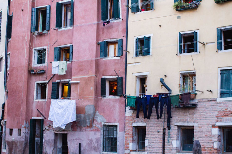 City Life Lines Architecture Building Building Exterior Built Structure City Clothesline Clothing Colorful Colorful Houses Day Drying Drying Clothes Laundry Light In The Window No People Outdoors Urban Life Venice Life Vibrant Color Window Window Shutter