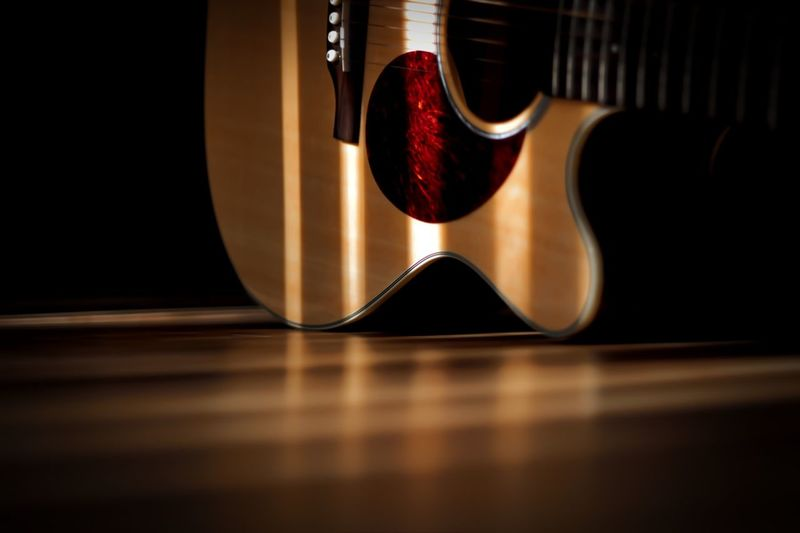 Surface level of guitar on wooden table