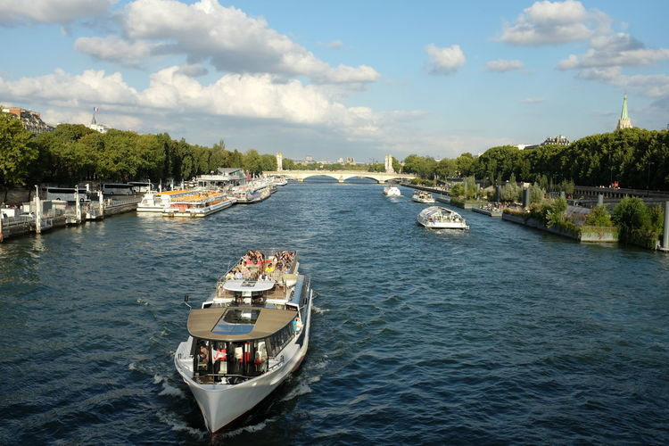 Ferry Boat In Seine River Against Sky