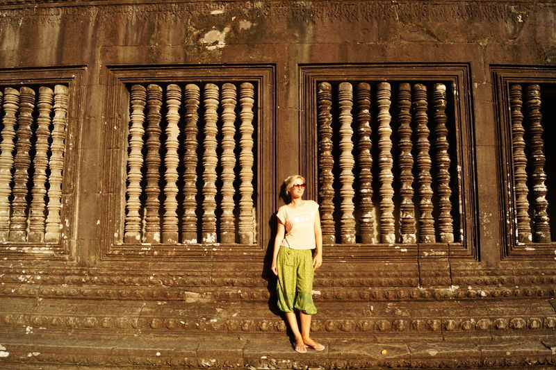 Woman Standing Against Temple