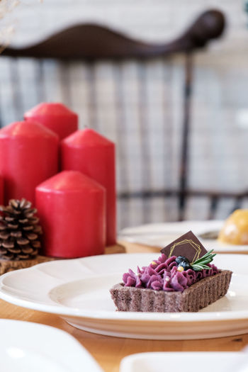 Table Food And Drink Focus On Foreground Food No People Indoors  Still Life Freshness Close-up Basket Container Sweet Food Plate Dessert Plant Sweet Day Flower Cake Kitchen Utensil Temptation Purple