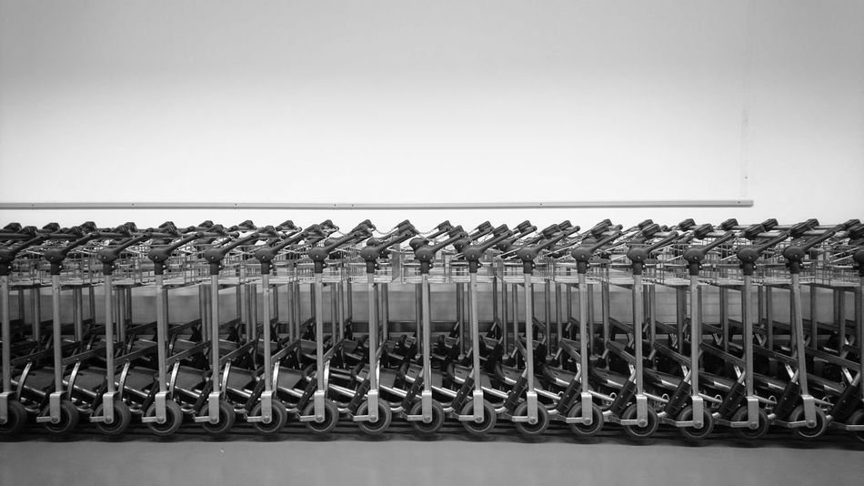 Connected By Travel and waiting to claim the luggage. Order In A Row Large Group Of Objects Day Indoors  Travel Destinations Collection Collecting Stuff Baggage Starting A Trip Coming Home Symmetry Luggage Luggage Trolleys Trolley Fresh On Market 2017